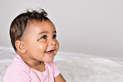 month-old-baby-smiling-girl-profile-43887814